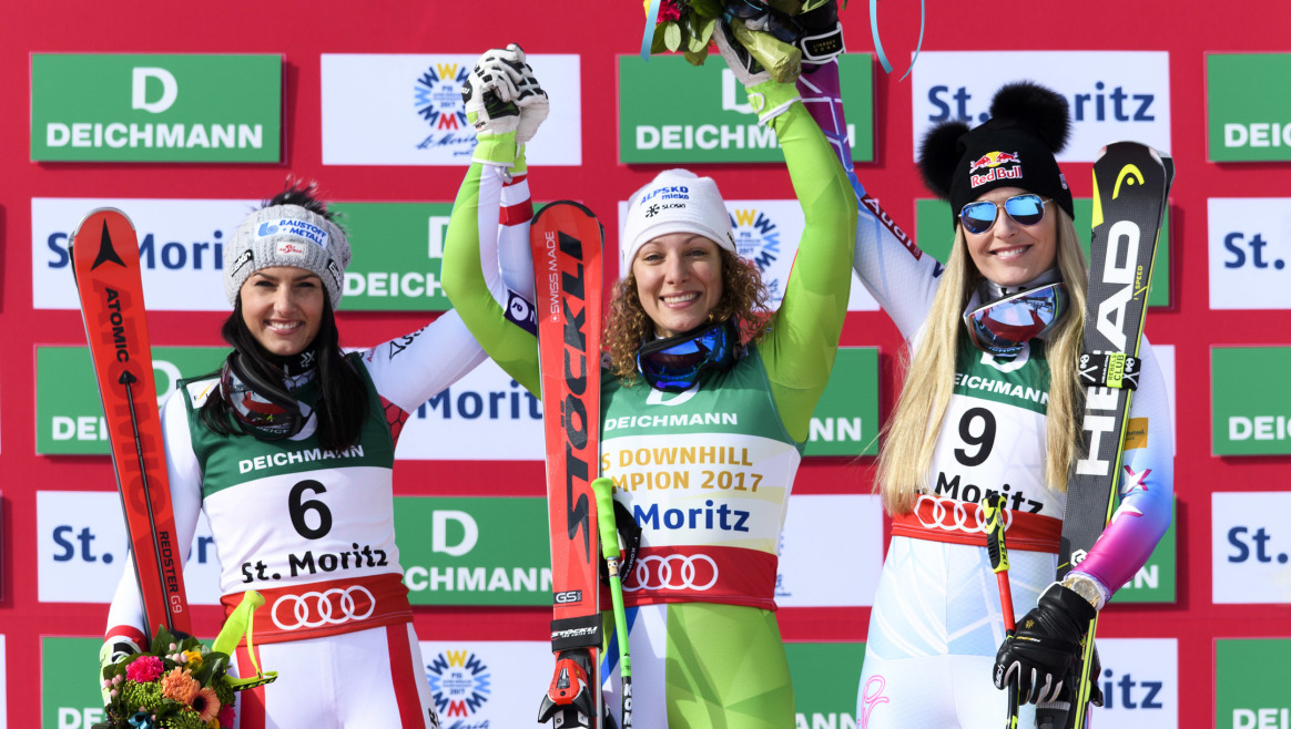 From left, Silver medalist Stephanie Venier of Austria, Gold medalist Ilka Stuhec of Slovenia and Bronze medalist Lindsey Vonn of the USA celebrate on the podium during the women's downhill race at the 2017 FIS Alpine Skiing World Championships in St. Moritz, Switzerland, Sunday, Feb. 12, 2017. (Peter Schneider/Keystone via AP)