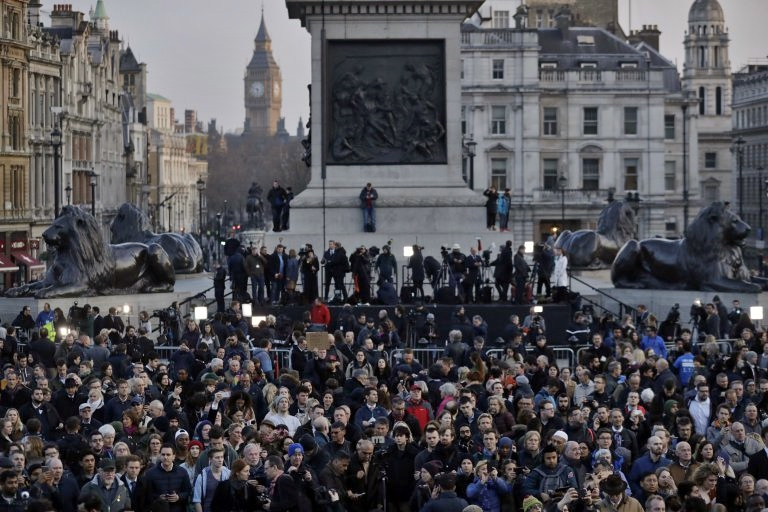Crowds gather at a vigil for the victims of Wednesday's attack, at Trafalgar Square in London, Thursday, March 23, 2017. The Islamic State group has claimed responsibility for an attack by a man who plowed an SUV into pedestrians and then stabbed a police